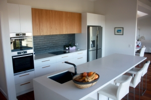 60mm Ceasarstone benchtop with contrast veneer doors - kitchen in Seaforth
