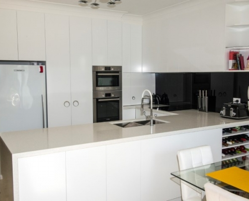 black glass splash back with gloss doors