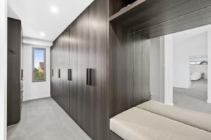 dark timber wardrobe doors in custom walk in robe