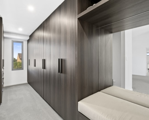 dark timber wardrobe doors in custom walk in robe