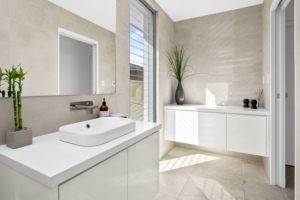 white ceasar stone with concrete look tiles powder room reno
